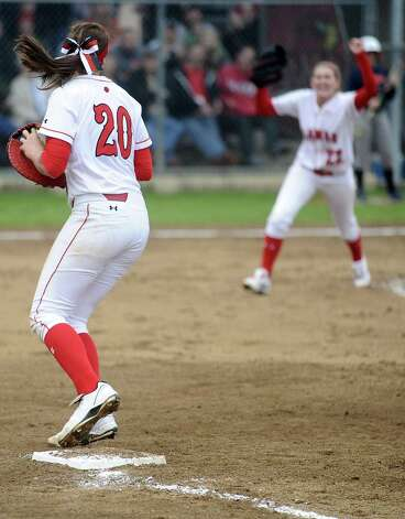 Lamar player Ashley McDowell, #20, pulls a double play at first place by catching a line drive and stepping on the bag during the Lamar University softball game against UTSA at Ford Park on Saturday, February 9, 2013.  Lamar won over UTSA 3-2. Photo taken: Randy Edwards/The Enterprise Photo: Randy Edwards