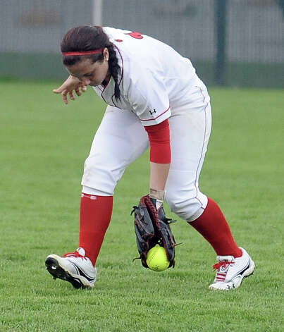 Lamar player Julianne Viator, #1, scoops up a ball in center field during the Lamar University softball game against UTSA at Ford Park on Saturday, February 9, 2013.  Lamar won over UTSA 3-2. Photo taken: Randy Edwards/The Enterprise Photo: Randy Edwards