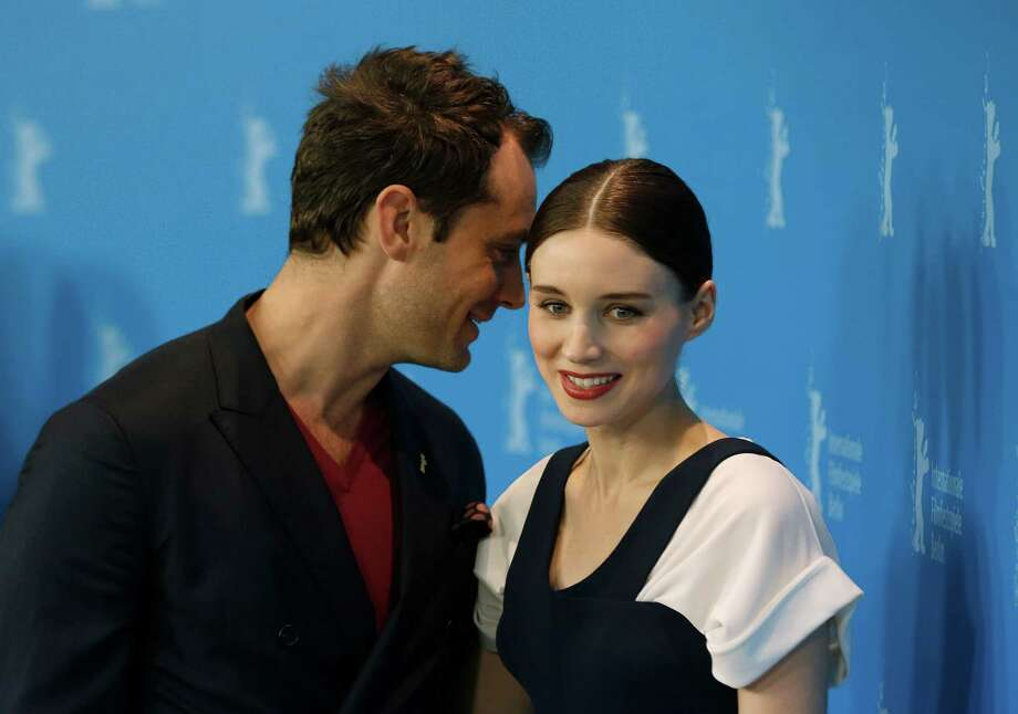 Actors Jude Law and Rooney Mara pose for photographers at the photo call for the film Side Effects at the 63rd edition of the Berlinale, International Film Festival in Berlin, Tuesday, Feb. 12, 2013. (AP Photo/Gero Breloer) Photo: Gero Breloer