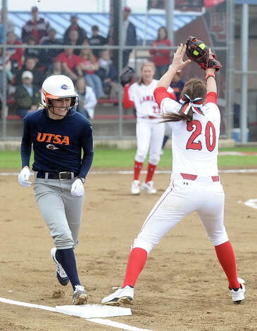 Lamar player Ashley McDowell, #20, reaches at first to beat out UTSA player Darian Blake, #7, during the Lamar University softball game against UTSA at Ford Park on Saturday, February 9, 2013.  Lamar won over UTSA 3-2. Photo taken: Randy Edwards/The Enterprise Photo: Randy Edwards