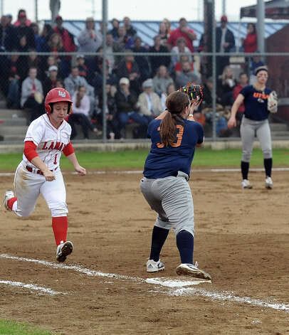 Lamar player Julianne Viator, #1, is thrown out at first after a beautiful bunt down the third base line during the Lamar University softball game against UTSA at Ford Park on Saturday, February 9, 2013.  Lamar won over UTSA 3-2. Photo taken: Randy Edwards/The Enterprise Photo: Randy Edwards