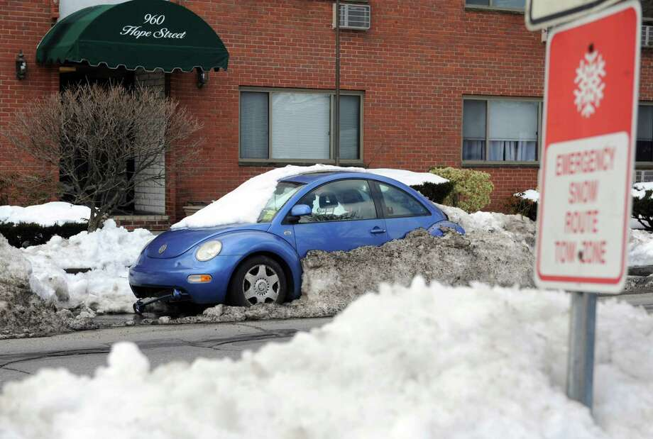 A vehicle sits encased in snow on Hope Street in Stamford, which is an Emergency Snow Route, on Tuesday, February 12, 2013. Photo: Lindsay Perry / Stamford Advocate
