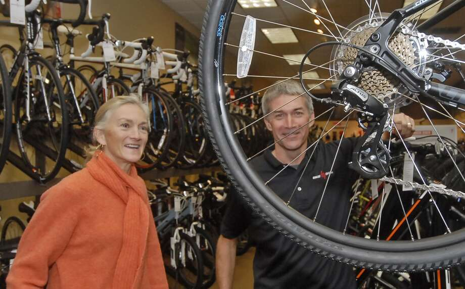 Lee Neathery, left, and Neil Bremner stay up with changing trends in cycling at  their Bike Barn shop at  12118 Westheimer. Photo:  Tony Bullard 2012, Freelance Photographer / © Tony Bullard & the Houston Chronicle