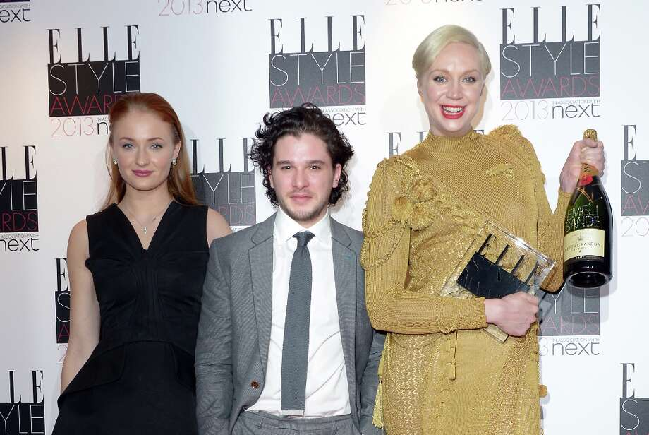 From left, Sophie Turner, Kit Harington, and Gwendoline Christie with the award for 'Best TV Show' for 'Game of Thrones' at the ELLE Style Awards at the Savoy Hotel in London on Monday, Feb. 11, 2013. (Photo by Jon Furniss/Invision/AP) Photo: Jon Furniss, Associated Press / Invision