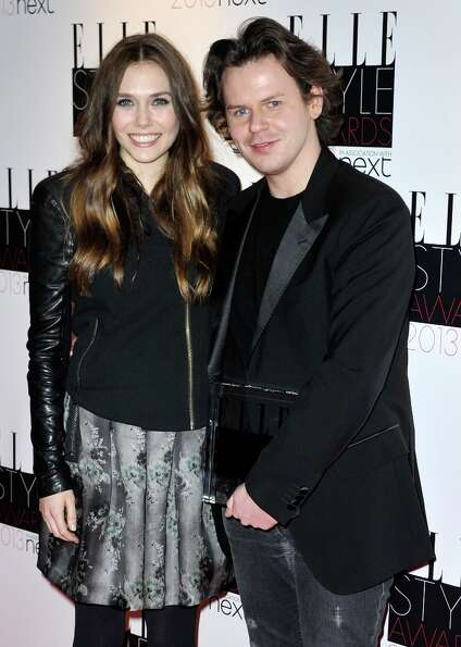 Elizabeth Olsen and Best Britsh Designer of the Year winner Christopher Kane poses in the press room