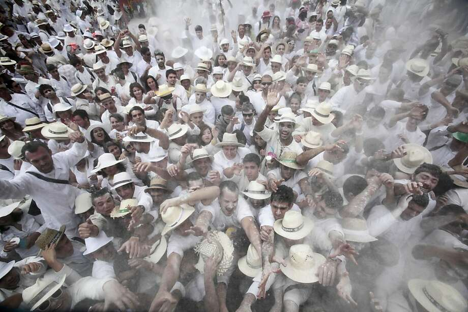 Powder to the people! White-hatted revelers throw talcum at one another during the carnival of Los Indianos (the Indians) in Santa Cruz de la Palma, on the Canary island of Las Palma. Photo: Desiree Martin, AFP/Getty Images