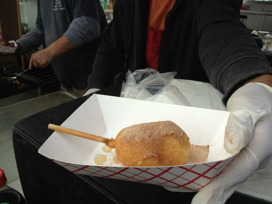 Deep fried butter on a stick is served at Gary Morris's booth in the food court at the San Antonio Stock Show & Rodeo. Don't worry, pixels are calorie free. Photo: Sarah Tressler/Express-News