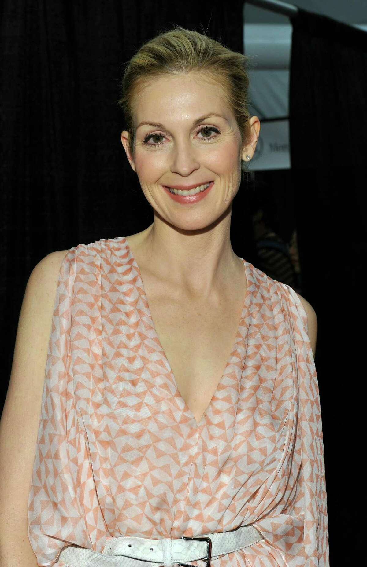 NEW YORK, NY - FEBRUARY 15: Actress Kelly Rutherford poses backstage at the Dennis Basso Fall 2011 fashion show during Mercedes-Benz Fashion Week at The Stage at Lincoln Center on February 15, 2011 in New York City.