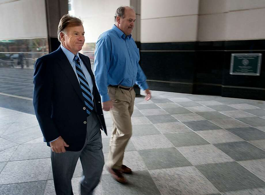Former head of SK Foods Frederick Scott Salyer (left), accompanied by friend Calvin Carter, pleaded guilty to 11 felony charges in March. Photo: Randall Benton, Associated Press