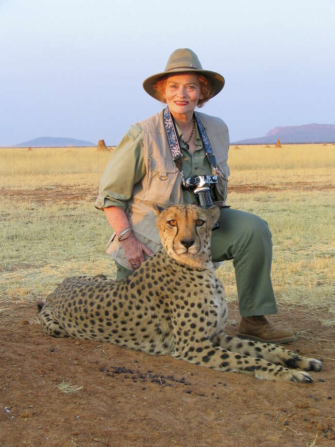 Local conservationist Mary Virginia McCormick Pittman-Waller poses with a cheetah at an animal preserve in Africa. She has traveled the world to save endangered species. Photo: Courtesy Mary Virginia McCormick