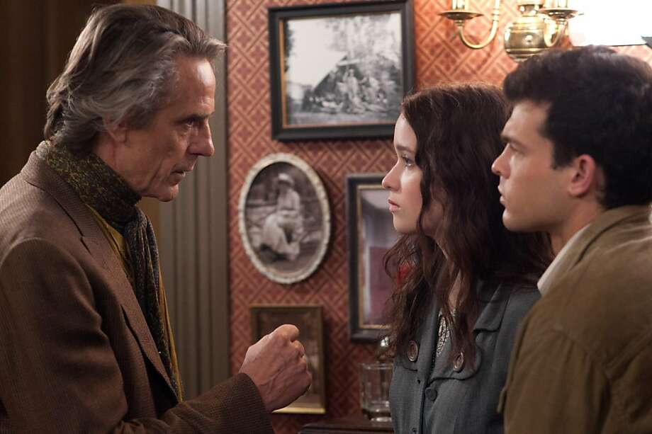"Uncle Macon Ravenwood (Jeremy Irons, left) keeps an eye on young couple Lena (Alice Englert) and Ethan (Alden Ehrenreich) in ""Beautiful Creatures."" Photo: John Bramley, Warner Bros."