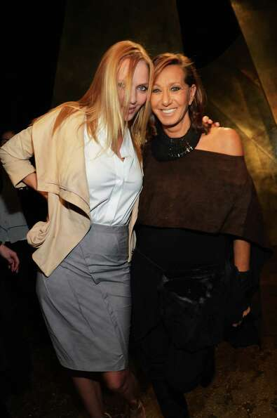 Actress Uma Thurman (L) and designer Donna Karan attend the Donna Karan New York Fall 2013 fashion s