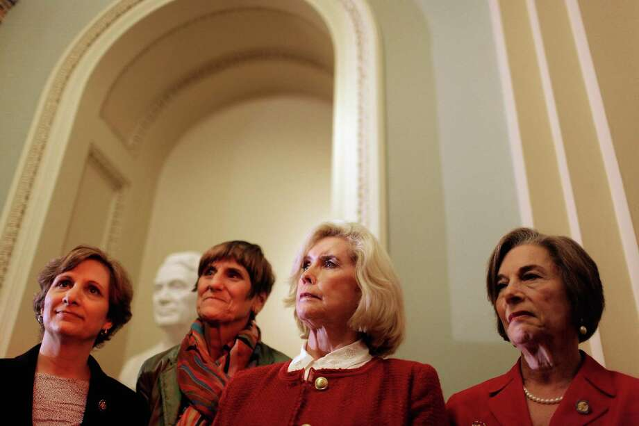 Five years after the passage of the Lilly  Ledbetter Fair Pay Act of 2009, pay parity is still an issue in Texas. The act's namesake, Lilly Ledbetter, is third from left. Photo: Getty Images / 2012 Getty Images