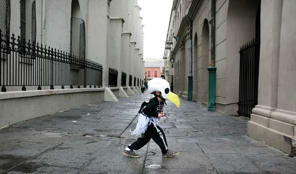 Brody Bell, 6, of New Orleans, runs across Pierre Antoine Alley dressed as a bald eagle skeleton for Mardi Gras Day. Fat Tuesday, the traditional celebration on the day before Ash Wednesday and the begining of Lent. Photo: Rusty Costanza, Getty Images / 2013 Getty Images