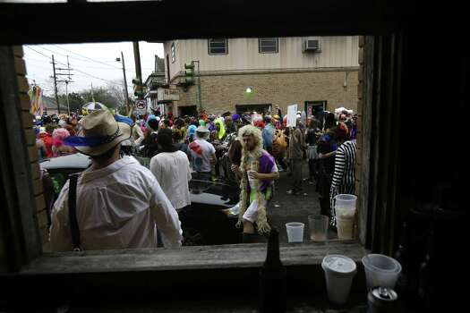 Revelers gather for the start of the Society of Saint Anne walking parade in the Bywater section of New Orleans during Mardi Gras day. Photo: Gerald Herbert, Associated Press / AP