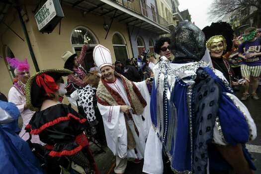 A man dressed as the Pope revels with other costumed people during Mardi Gras in the French Quarter of New Orleans. Photo: Gerald Herbert, Associated Press / AP