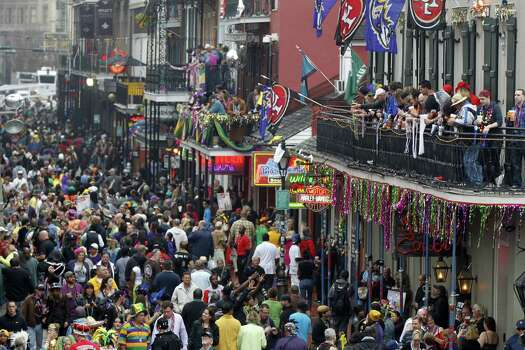 Crowds of revelers are seen on Bourbon Street from the balcony of the Royal Sonesta Hotel during Mardi Gras in New Orleans. Photo: Gerald Herbert, Associated Press / AP