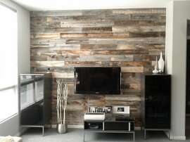 Stikwood thin wood planks have an adheave backing and can be applied to walls, ceilings and furniture.
