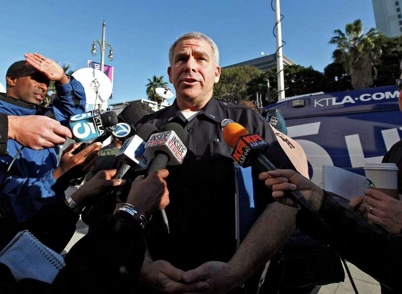 LAPD spokesman Lt.  Andrew Newman talks to reporters at a news conference in Los Angeles, Tuesday, F
