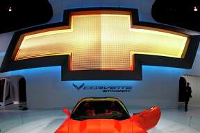 The 2014 Chevrolet Corvette Stingray is revealed at the Chicago Auto Show Thursday, Feb. 7, 2013, in Chicago. (AP Photo/Charles Rex Arbogast)
