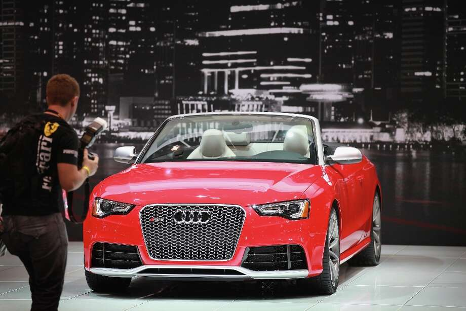 CHICAGO, IL - FEBRUARY 07:  A visitor looks the Audi RS5 during the media preview at the Chicago Auto Show on February 7, 2013 in Chicago, Illinois. The Chicago Auto Show, one of the oldest and largest in the country, will be open to the public February 9-18. Photo: Scott Olson, Getty Images / 2013 Getty Images