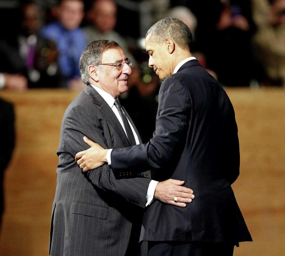 President Barack Obama embraces Secretary of Defense Leon Panetta during a farewell ceremony. Photo: Associated Press
