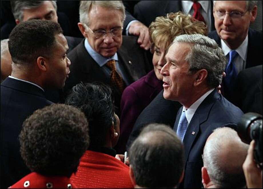 Greeting President George W. Bush, along with then-Rep. Jesse Jackson Jr., 2007. Photo: Rich Lipski