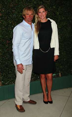 Pro surfer Laird Hamilton and volleyball player Gabrielle Reece wed in 1997 and live the life splitting their time between residences in Malibu and Hawaii. Photo: David Livingston, Getty Images / ONLINE_YES