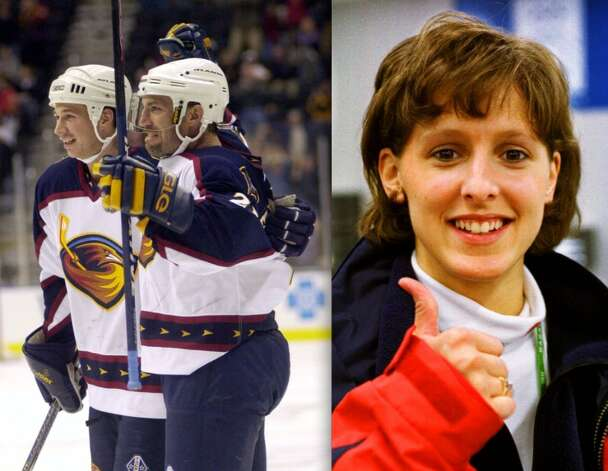 Ray Ferraro (with arms raised) and Cammi Granato are the ultimate hockey power couple. Ferraro played 18 seasons in the NHL, and Granato was the captain of the US women's hockey team that won gold in the 1998 Olympics.
