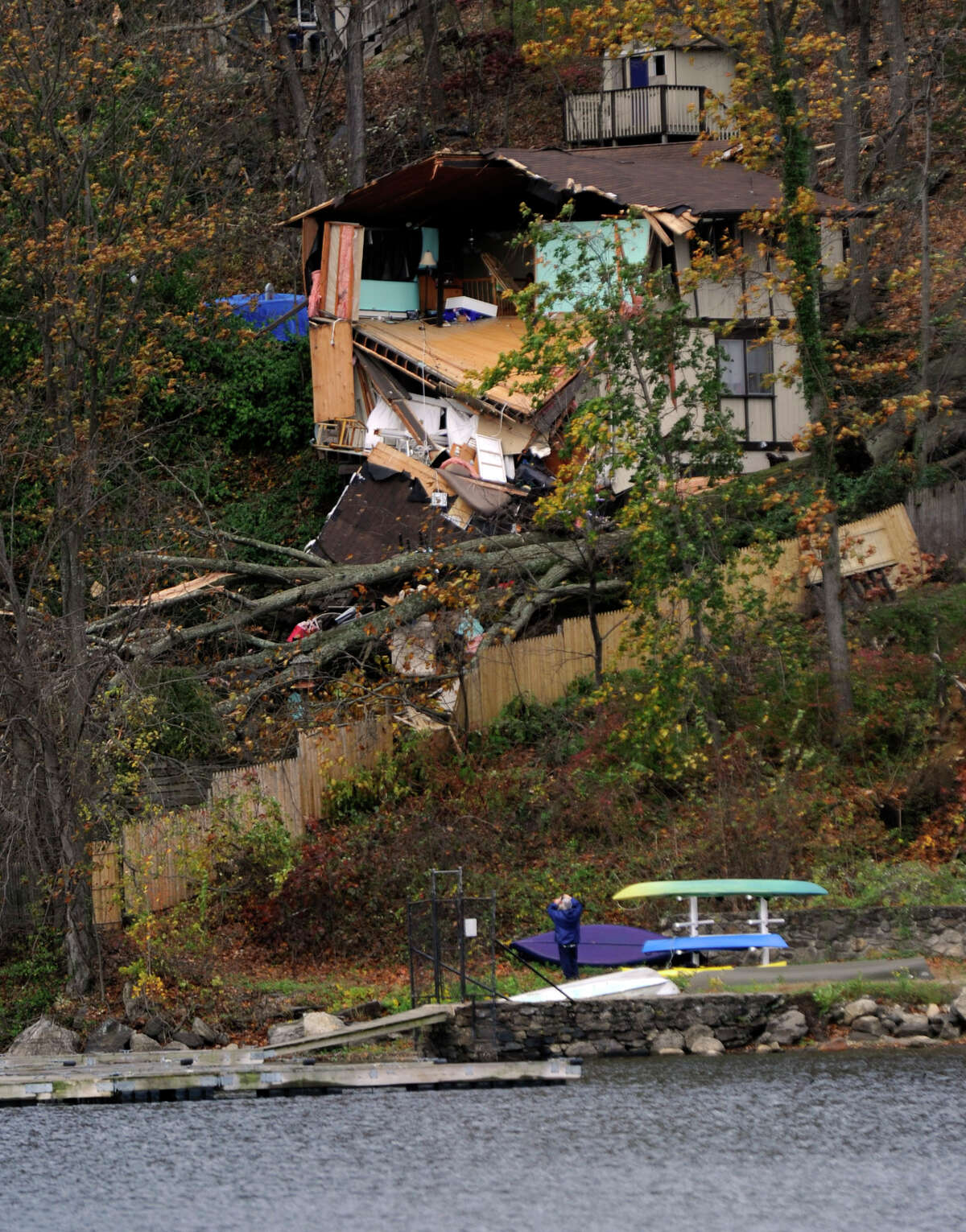 This house overlooking Candlewood Lake near the Pleasant Acres Beach in Danbury, Conn. was heavily damaged reportedly by falling trees from the high winds of Hurricane Sandy, Tuesday, Oct. 30, 2012.