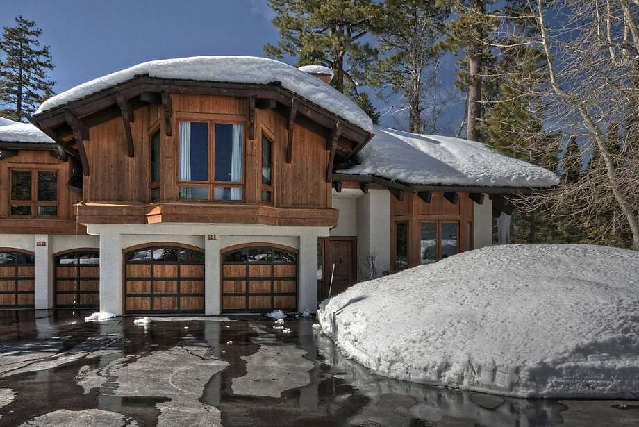 The two-level home has four bedrooms and is about 100 yards from Lake Tahoe. Photo: Lake Tahoe Digital Productions