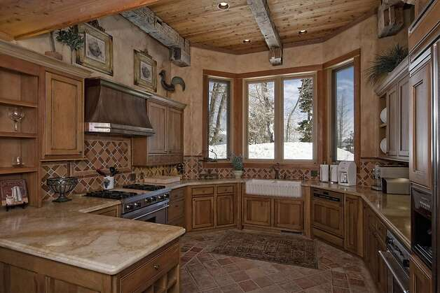 The kitchen faces the slopes and features stainless steel appliances. Photo: Lake Tahoe Digital Productions