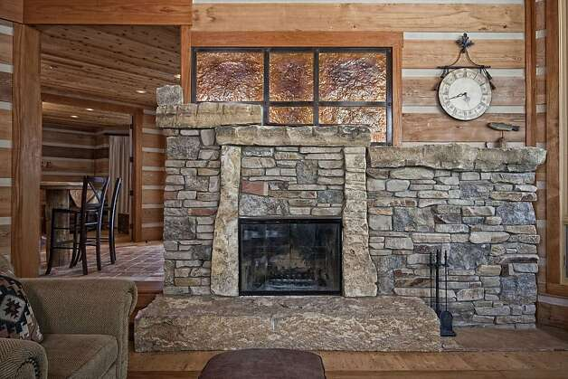 The stone hearth is a centerpiece on the home's lower level. Photo: Lake Tahoe Digital Productions