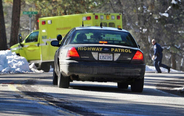 Law enforcement officials respond after Christopher Dorner, the fugitive ex-Los Angeles cop sought in three killings, engaged in a shootout with authorities that wounded two officers in the San Bernardino Mountains near Big Bear Lake, Calif., Tuesday, Feb. 12, 2013. (AP Photo/The Sun, Rachel Luna) MANDATORY CREDIT Photo: Rachel Luna, AP / San Bernardino Sun