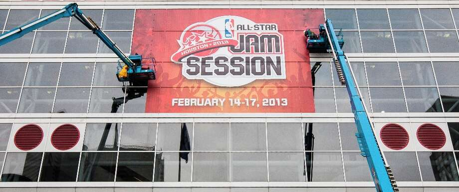 Signage for the NBA All-Star Jam Session is installed on the windows of the George R. Brown Convention Center in preparation for the NBA's All-Star week on Monday. Photo: Nick De La Torre / © 2013 Houston Chronicle