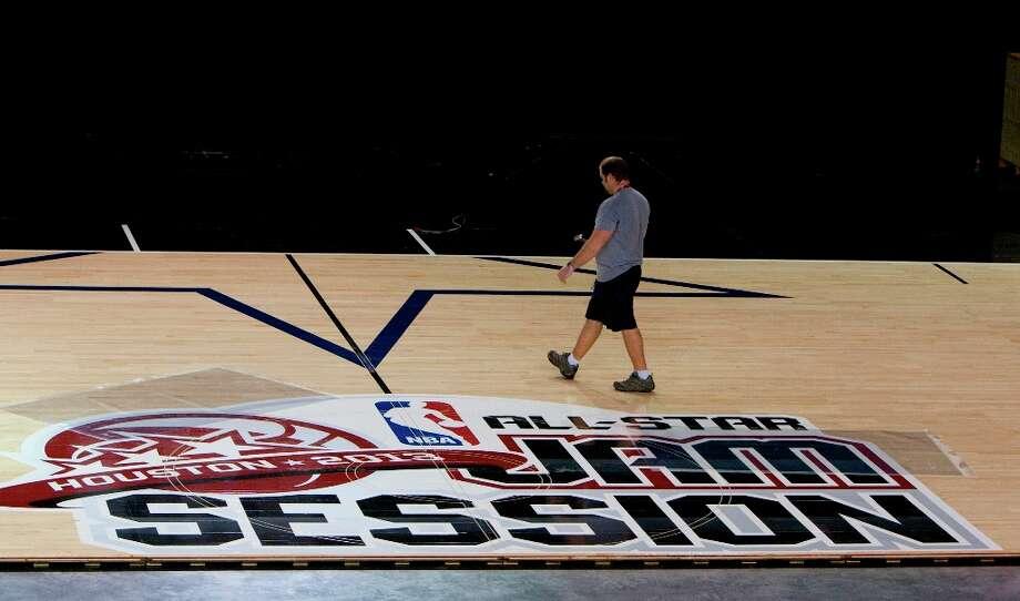 Rob Rottier walks through the Center Court. Photo: Cody Duty / © 2013 Houston Chronicle
