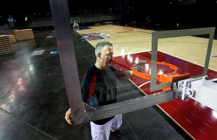 Ruey Peck prepares a goal at at the Center Court exhibit. Photo: Cody Duty / © 2013 Houston Chronicle