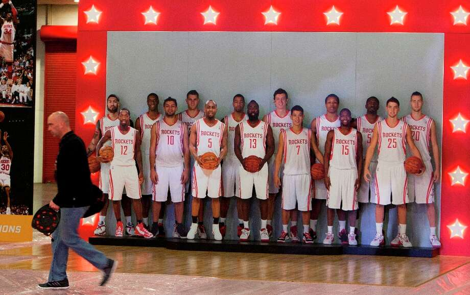 Dave Verhoeven walks in front of a life-size cutout of the Rockets' entire roster at the George R. Brown Convention Center. Photo: Cody Duty / © 2013 Houston Chronicle