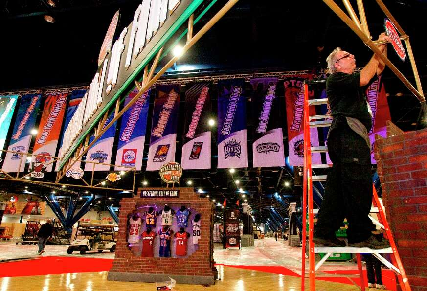 Burr Willcox prepares the Basketball Hall of Fame exhibit at the George R. Brown Convention Center.
