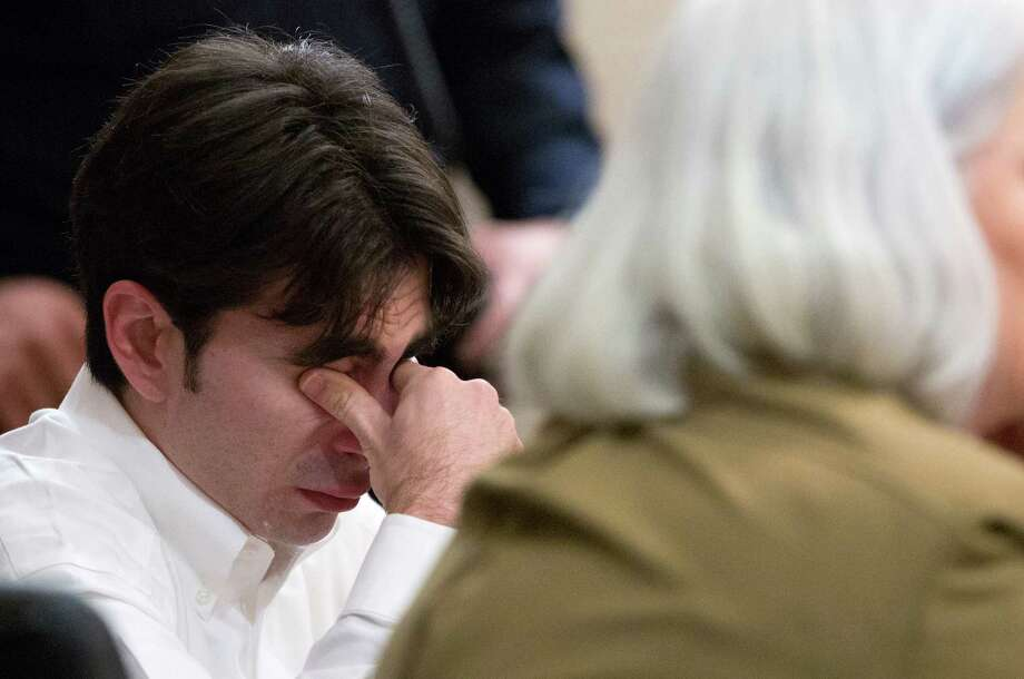 Robert Stinziano wipes his eyes after pleading guilty to intoxication manslaughter. Photo: William Luther, San Antonio Express-News / © 2013 San Antonio Express-News