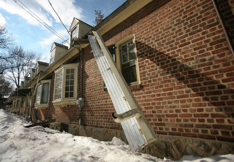 A gutter collapsed from the weight of snow from last weekend's storm in Seaside Village in Bridgepor