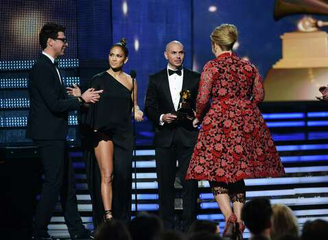 "LOS ANGELES, CA - FEBRUARY 10:  Singers Jennifer Lopez,  Pitbull present Adele the Best Pop Solo Performance for ""Set Fire to the Rain (Live)"" onstage at the 55th Annual GRAMMY Awards at Staples Center on February 10, 2013 in Los Angeles, California. Photo: Kevork Djansezian, Getty Images / 2013 Getty Images"