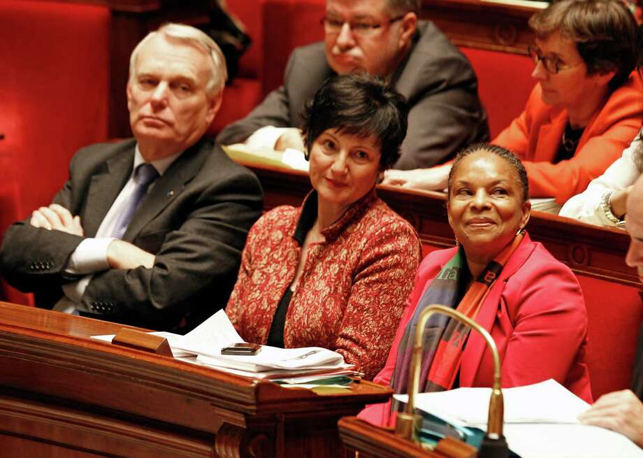 French justice minister Christiane Taubira, right, social affairs minister Dominique Bertinotti and prime minister Jean Marc Ayrault, observe Tuesday's vote. Photo: Remy De La Mauviniere, STF / AP