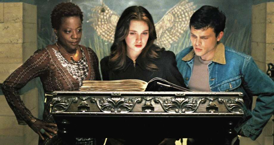 (L -r) VIOLA DAVIS as Amma, ALICE ENGLERT as Lena Duchannes and ALDEN EHRENREICH as Ethan Wate in Alcon Entertainment's supernatural love story â??BEAUTIFUL CREATURES,â? a Warner Bros. Pictures release. Photo: Warner Bros. Pictures