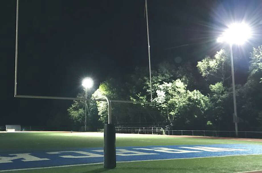 The lights at Staples High School's stadium, shown in a final test last final, were used inadvertantly, according to the town attorney, for a football practice in November -- an event that should not penalize one of two Saturday night events planned at the athletic field in May. Photo: File Photo / Westport News