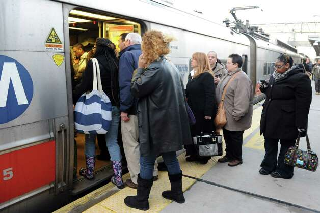 A combined train from Grand Central Station arrives in Stamford on Tuesday, February 12, 2013. Photo: Lindsay Perry / Stamford Advocate