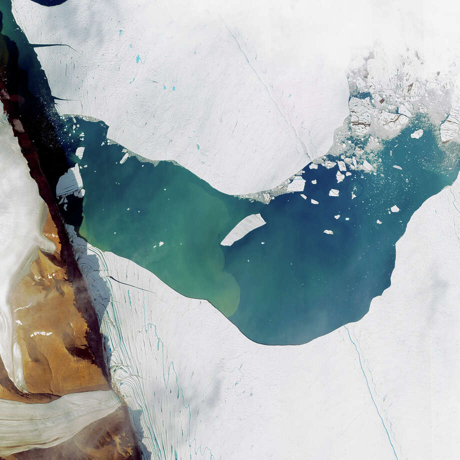 This is a satellite image of a massive iceberg calving from the Petermann Glacier in Greenland, collected on July 19, 2012.  (Photo DigitalGlobe via Getty Images) Photo: DigitalGlobe, Multiple / 2012 DigitalGlobe