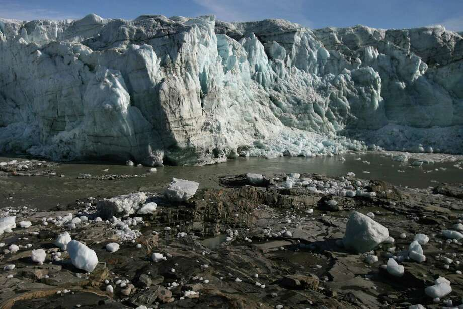Ice boulders are seen under the Russell Glacier, September 01, 2007 , Greenland. Scientists believe that Greenland, with its melting ice caps and disappearing glaciers, is an accurate thermometer of global warming. (Photo by Uriel Sinai/Getty Images) Photo: Uriel Sinai, Multiple / 2007 Getty Images