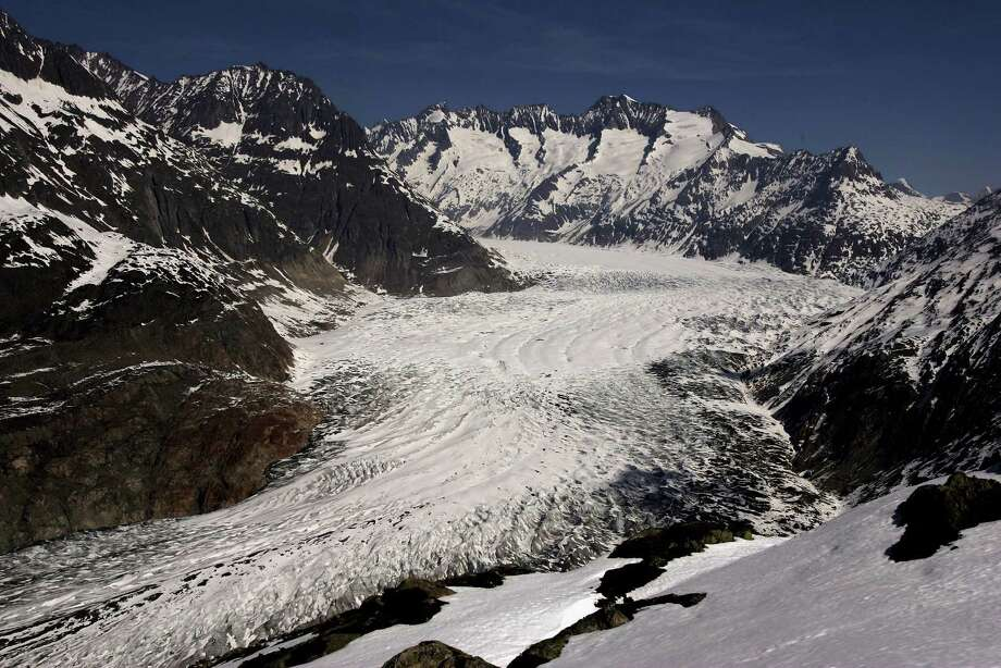 Snow melts at Aletsch Glacier south to north from Moosfluo point April 21, 2007 near Brig, Switzerland. The Aletsch Glacier is the largest glacier in the Alps, covering more than 120 square kilometers (more than 45 square miles) and is declared part of the UNESCO world nature heritage. Unseasonably warm weather temperatures across Switzerland melted snow even in Alpine altitudes.  (Photo by Johannes Simon/Getty Images) Photo: Johannes Simon, Multiple / 2007 Getty Images