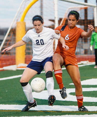 Roosevelt's Jeanna Mullen (left) fights for the ball with Madison's Kianna Washington near the Madison goal during the second half of their 0-0 tie Feb. 8 at Comalander Stadium. Photo: Marvin Pfeiffer / NE Herald